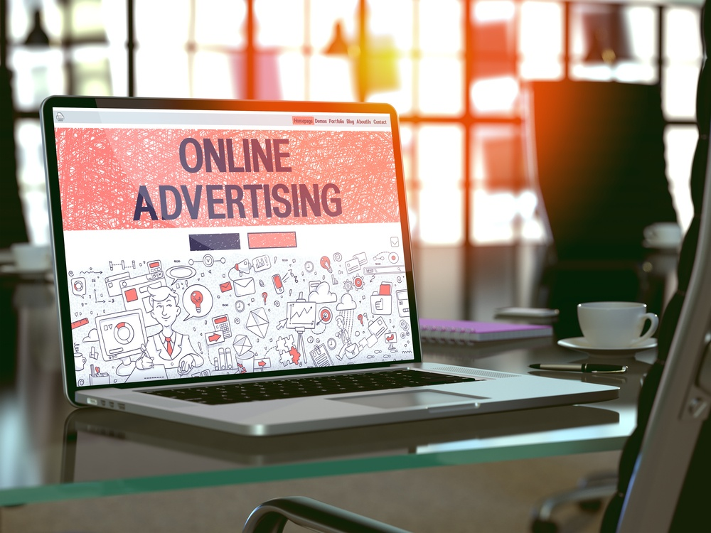Online Advertising Concept. Closeup Landing Page on Laptop Screen in Doodle Design Style. On Background of Comfortable Working Place in Modern Office. Blurred, Toned Image. 3D Render..jpeg
